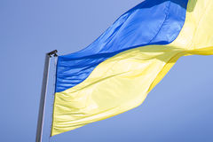 Blue and yellow national flag of Ukraine waving in the air Stock Photos