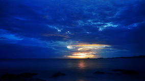 Blue and yellow ocean sunrise stock video footage