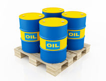 Blue and yellow oil barrels Royalty Free Stock Images