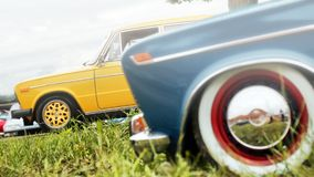 Blue and yellow Oldtimer VAZ 2103 with white wall wheels stock photography