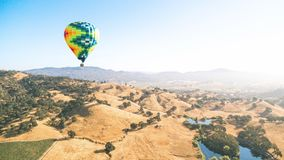 Blue Yellow and Orange Air Balloon Flying Stock Photo