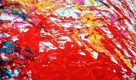 Yellow red painting blurred abstract vivid background, texture and strokes of brush. Blue yellow orange red phosphorescent blurred bright vivid hues. Abstract royalty free stock photo