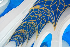 Blue and yellow ornamental church ceiling (nave) and white arches. Fragment Royalty Free Stock Photography