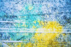 Blue and yellow paint background texture with grunge brush strokes royalty free stock image