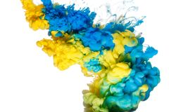 Blue and yellow paint splash isolated on white background. Close up royalty free stock photo