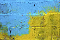 Blue-yellow paint on a wall Royalty Free Stock Photography
