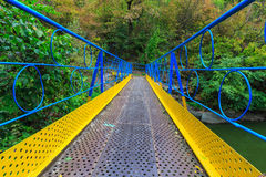 Blue and yellow painted bridge Stock Photography