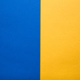 Blue and yellow paper background. Complementary colors pantone Stock Photo