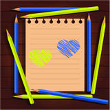 Blue yellow pencils, draw a heart. Yellow and blue pencils on paper painted heart Royalty Free Stock Image