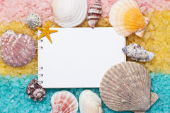 Blue yellow pink bath salt and blank notepad Stock Images