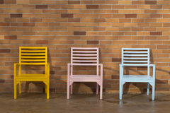 Blue yellow and pink wooden chair Stock Photos