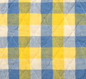 Blue and yellow plaid background. Color stripes quilted pattern on fabric Royalty Free Stock Image