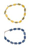 Blue and yellow plastic unisex necklace. Stock Photography