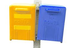 Blue and yellow post box. Isolated over white Royalty Free Stock Image