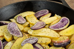 Blue and yellow potatoes in a skillet Royalty Free Stock Photography