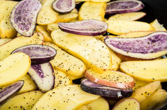 Blue and yellow potatoes in a skillet Stock Photography