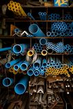 Blue and yellow PVC pipes in warehouse stock photo
