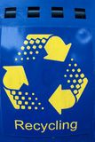 Blue and yellow recycle sign Stock Photography