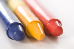 Blue Yellow Red Crayon. Blue, yellow, and red crayon on white stock photo
