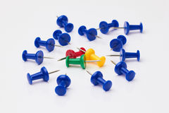 Blue, yellow, red and green thumbtacks. Royalty Free Stock Photos
