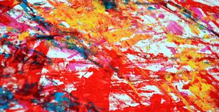 Blue yellow red orange paint blurred abstract vivid background, texture and strokes of brush. Blue yellow red phosphorescent blurred bright vivid hues. Abstract stock photography