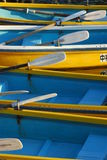 Blue and yellow rowboats Stock Images
