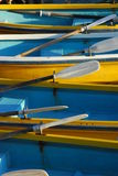 Blue and yellow rowboats Royalty Free Stock Image