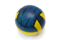 A blue and yellow rubber ball. A photo taken on an inflated blue and yellow stripes rubber balloon ball with fish symbols against a white backdrop stock photography