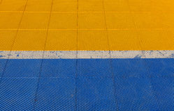 Blue And Yellow Rubber Flooring On Futsal Field Background Royalty Free Stock Photography