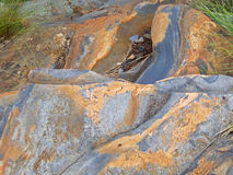 BLUE AND YELLOW SCULPTED ROCK. Blue and yellow shapely sculpted  rock Royalty Free Stock Photo
