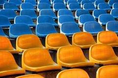 Blue and yellow seats Stock Photo