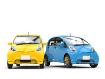 Blue and yellow small ecomonic electric cars side by side Stock Image