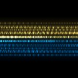 Blue yellow sparkling on dark abstract background Stock Images