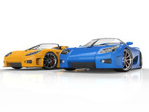 Blue and yellow sportscars on reflective background Royalty Free Stock Image