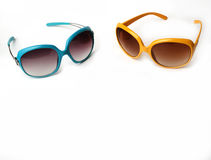 Blue and yellow sunglasses on a white background Stock Photo