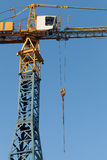 Blue and yellow tower crane fragment Stock Images