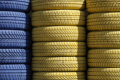 Blue and yellow tyres Stock Images