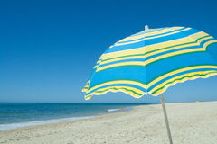 Blue and yellow umbrella Stock Image