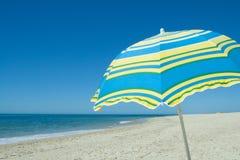 Blue and yellow umbrella Stock Image