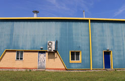 Blue and yellow warehouse Stock Photography