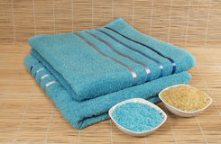 Blue yellow white towels on bamboo Mat Royalty Free Stock Photos