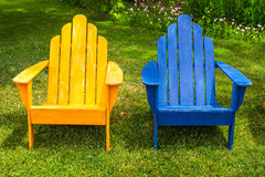 Blue & Yellow Wooden Lounge Chairs On Grass Stock Image