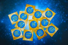 Blue yellow zodiac signs over blue horoscope like astrology concept. Zodiac signs symbols lying on blue horoscope like astrology esoteric magic mystic occult royalty free stock images