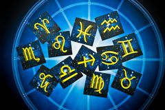 Blue yellow zodiac signs over blue horoscope like astrology concept. Zodiac signs symbols lying on blue horoscope like astrology esoteric magic mystic occult stock photography