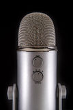 Blue Yeti Podcast Condenser Microphone. Isolated on black Stock Photo