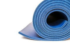 Blue yoga mat isolated on white background Royalty Free Stock Images