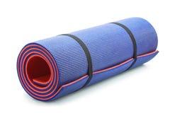 Blue yoga mat Stock Images