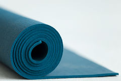 Blue yoga mat Royalty Free Stock Image
