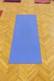 Blue yoga mat Stock Photos