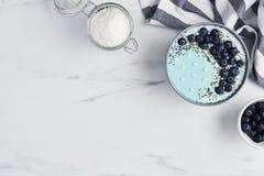 Free Blue Yogurt Smoothie Bowl Royalty Free Stock Images - 130778219